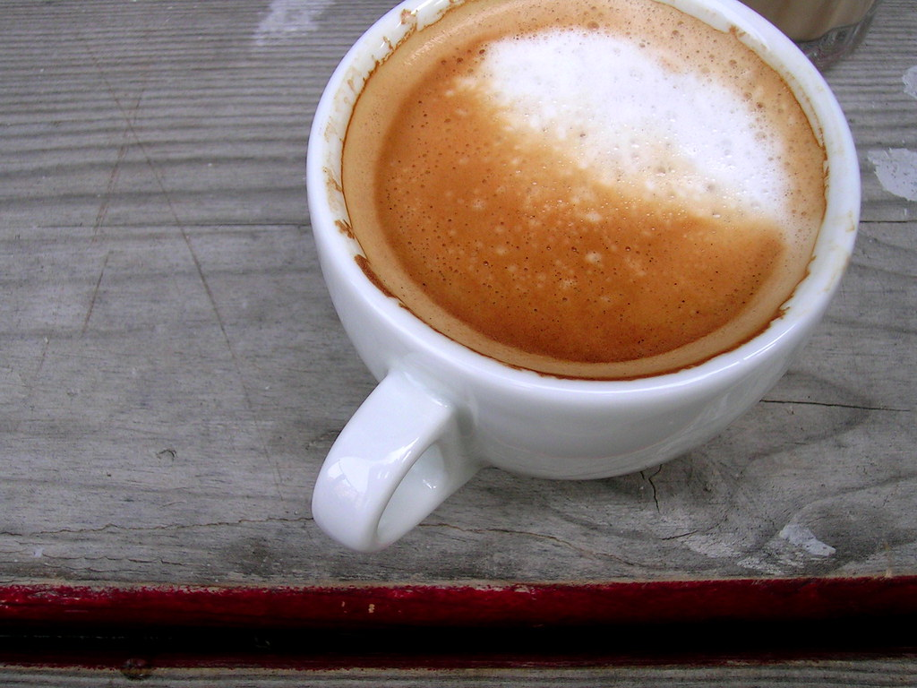 coffee in a porcelain mug on a wooden table