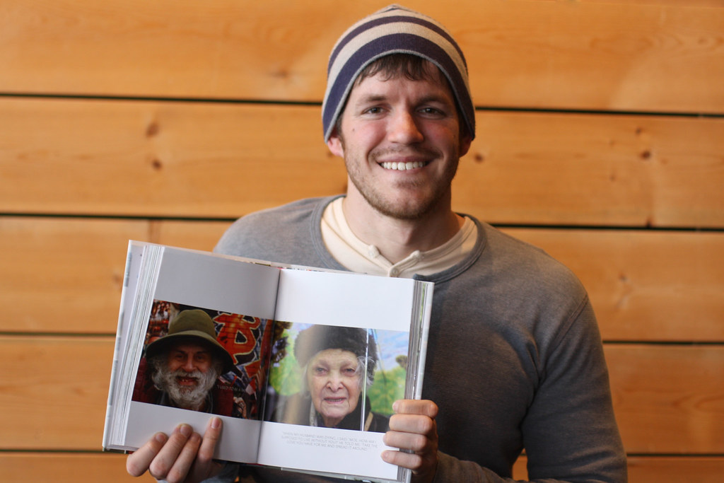 Portrait of Brandon Stanton with Humans of New York book