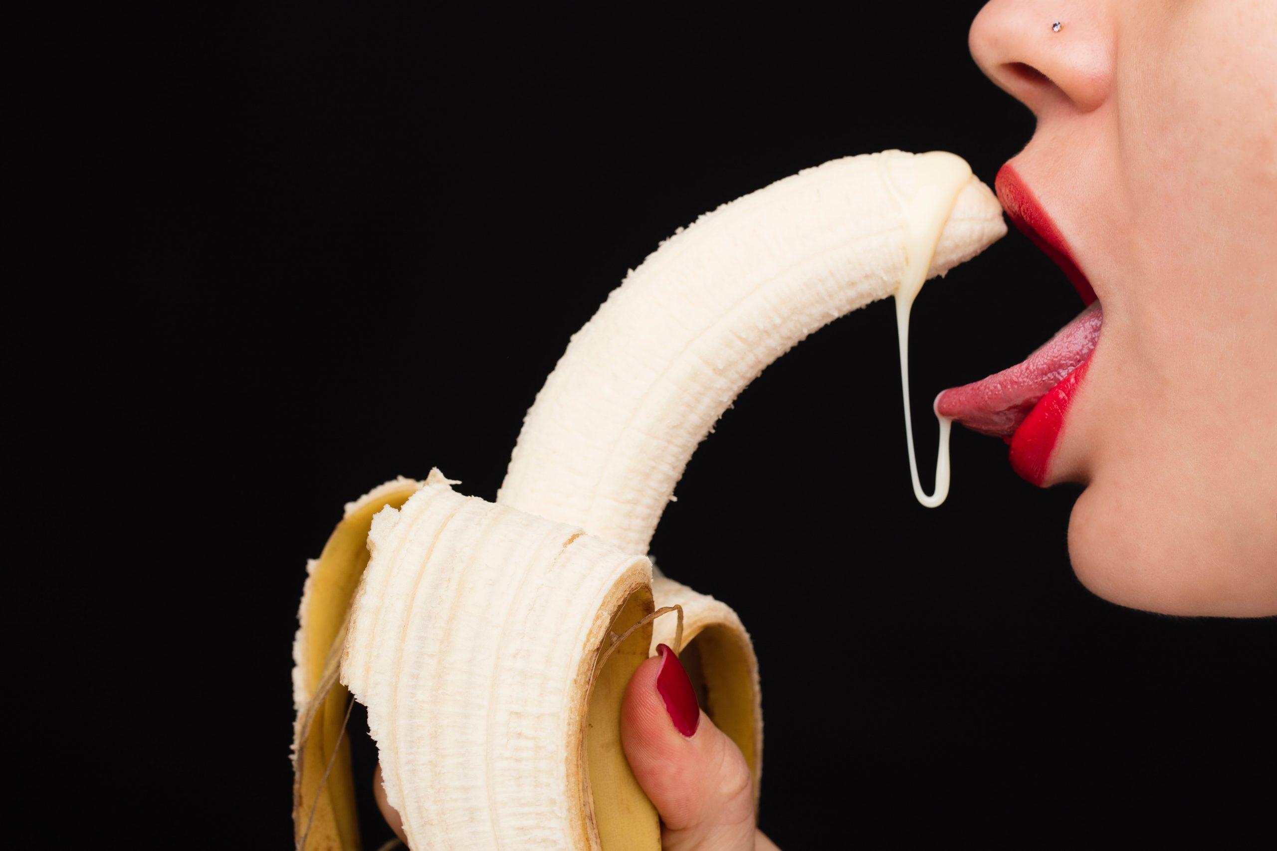 banana licked by woman