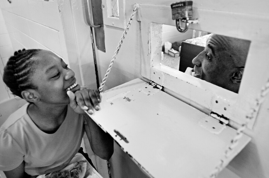 Girl visiting father in prison hospital ward