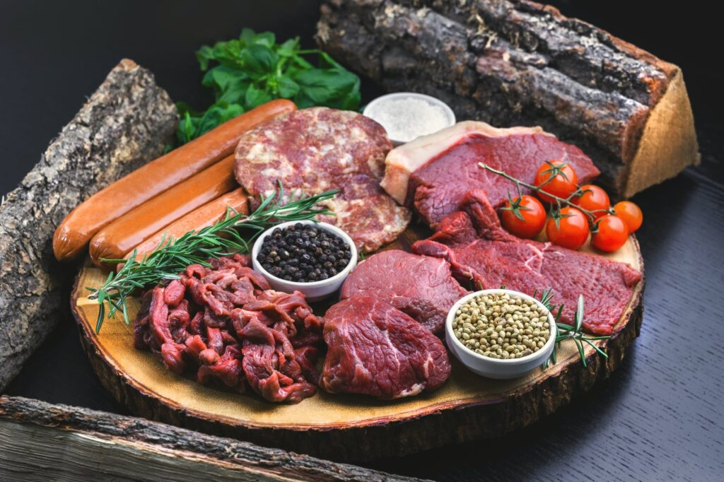 sliced meat on brown wooden tray