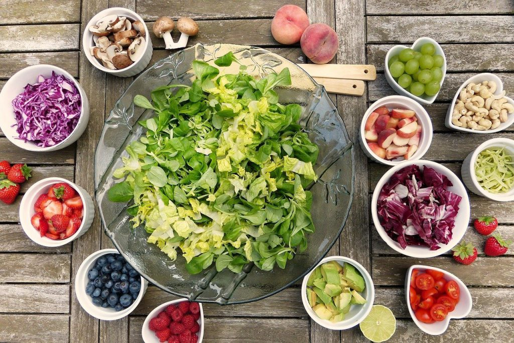 table of salad vegetables and fruit
