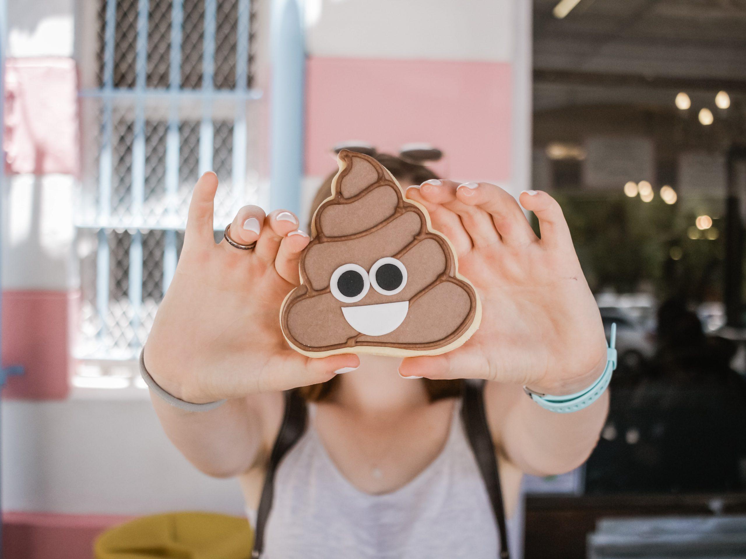 Woman holding poop emoji case