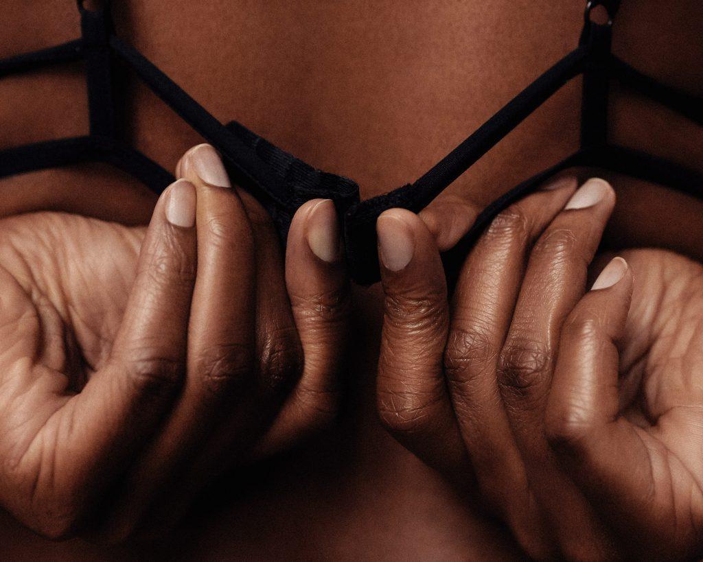 unfastening a bra, rearview